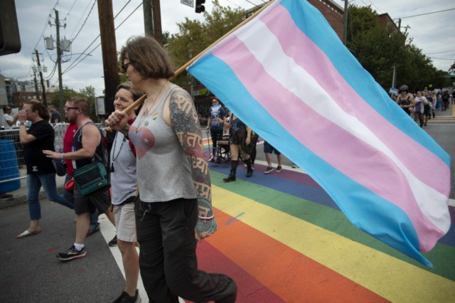 Members of Georgia's transgender and non-binary community stroll through the city's Midtown district during Gay Pride Festival's Transgender Rights March in Atlanta on Saturday, Oct. 12, 2019. (AP Photo/Robin Rayne)
