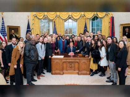 President Trump surrounded by a large group of worship leaders from across the country whom he invited to pray for him in the Oval Office Friday. (Official White House Photo by Tia Dufour)