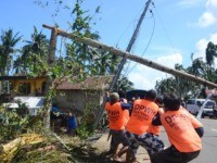 Workers pull a fallen electric pylon damaged at the height of Typhoon Phanfone in Salcedo town in Eastern Samar province on December 26, 2019. - Typhoon Phanfone swept across remote villages and popular tourist areas of the central Philippines on Christmas day claimed at least 16 lives, authorities said on …