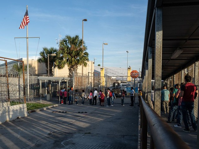 Dozens of people are seen waiting to enter the United States on the Northern side of the International Bridge over the Rio Grande, in Matamoros, Tamaulipas state, Mexico, on 05 November 2019. - There are around 2000 asylum seekers currently living in tents next to the International Bridge that connects …