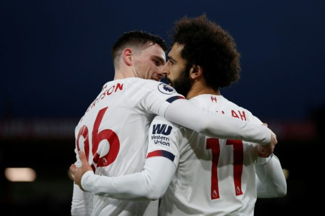 Liverpool's Mohamed Salah (right) celebrates scoring his team's third goal against Bournemouth