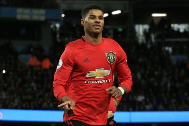 Marcus Rashford celebrates scoring from the penalty spot for Manchester United against Manchester City