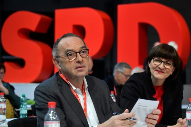 The newly elected co-leaders of Germany's SPD party have been given a mandated to seek more concessions from their CDU coalition partners