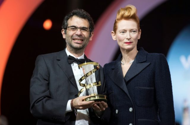 British actress Tilda Swinton presents the Etoile d'Or to Colombian director Nicolas Rincon Gille