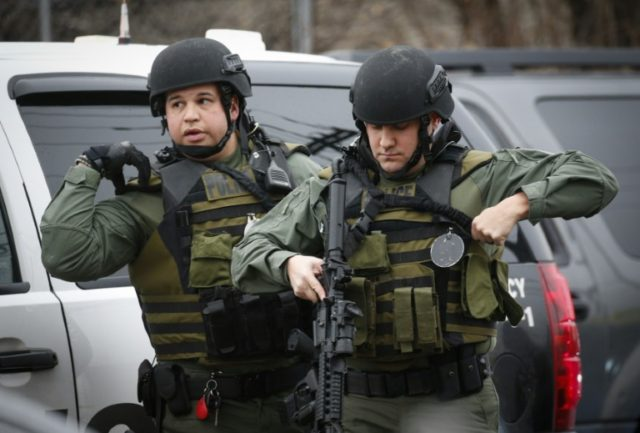 Hundreds of police from New Jersey and New York, including tactical officers armed with rifles and wearing olive-green fatigues, were deployed during the hours-long shootout in Jersey City