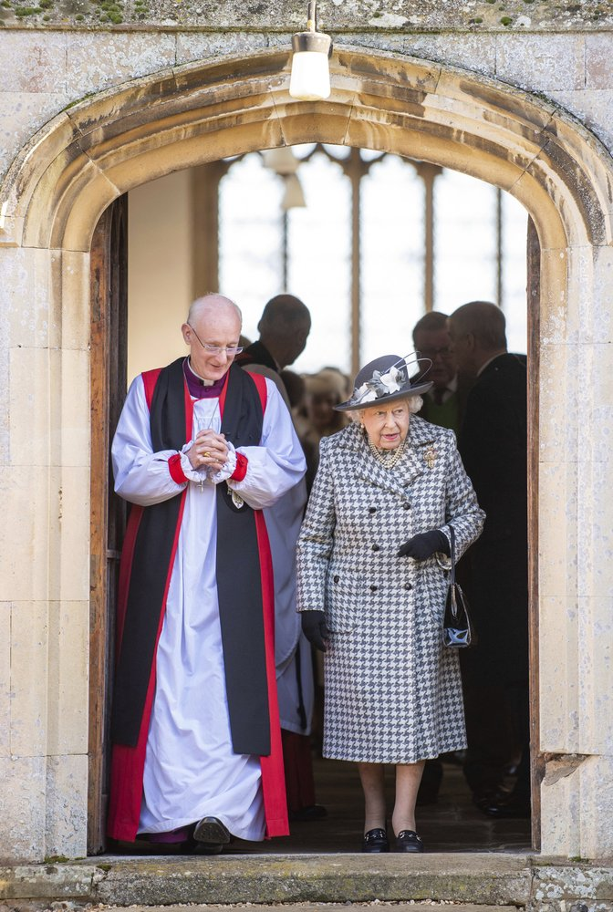"Britain's Queen Elizabeth II leaves after attending a church service at St Mary the Virgin, in Hillington, England, Sunday, Jan. 19, 2020. Buckingham Palace says Prince Harry and his wife, Meghan, will no longer use the titles ""royal highness"" or receive public funds for their work under a deal that allows them to step aside as senior royals. (Joe Giddens/PA via AP)"