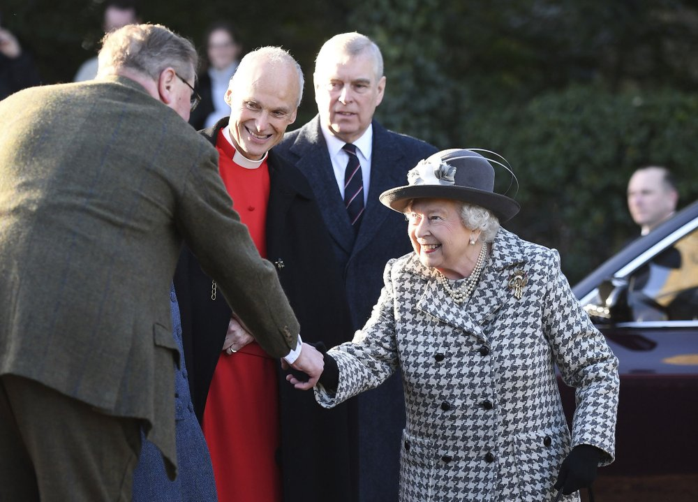 "Britain's Queen Elizabeth II, right, arrives at St Mary the Virgin, in Hillington, England, to attend a Sunday church service, Sunday, Jan. 19, 2020. Buckingham Palace says Prince Harry and his wife, Meghan, will no longer use the titles ""royal highness"" or receive public funds for their work under a deal that allows them to step aside as senior royals. Prince Andrew is at background centre. (Joe Giddens/PA via AP)"