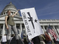 FILE - In this March 2, 2013, file photo, gun rights activist Holly Cusumano waves a flag during a rally for the 2nd Amendment at the Utah State Capitol in Salt Lake City. Legislators have sent Utah Gov. Gary Herbert a handful of gun bills that tighten and loosen oversight …