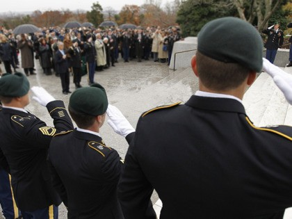 Members of the U.S. Army Special Forces Green Berets salute during a ceremony commemorating the 50th anniversary of President John F. Kennedy's designation of the name of the Special Forces Green Berets, Thursday, Nov. 17, 2011, at Arlington National Cemetery in Arlington, Va. (AP Photo/Ann Heisenfelt)