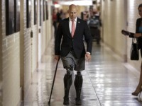 Rep. Brian Mast, R-Fla., walks to a meeting with fellow Republicans on Capitol Hill in Washington, Friday, July 14, 2017, to reconcile the GOP's long-overdue budget blueprint, even as divisions between moderates and conservatives over cutting programs like food stamps threaten passage of the measure. Mast, a combat veteran and …