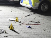 Markers placed on the ground inside cordoned-off area in front of a police station in Gelsenkirchen, Germany, late Sunday, Jan. 5, 20120. A 23-year-old police inspector candidate shot dead a man on Sunday evening as the man attempted to assault officers with an object and a knife. (Stephan Witte/dpa via …