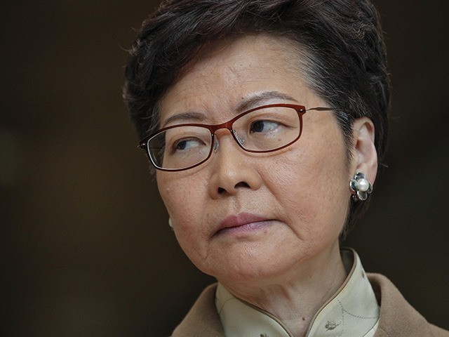 """Hong Kong Chief Executive Carrie Lam listens to a question from a journalist during a news conference at the Office of the Chief Executive in Hong Kong, Tuesday, Jan. 7, 2020. Lam said the city faces multiple challenges in the new year, including """"violence, economic tribulation and a health scare"""" …"""