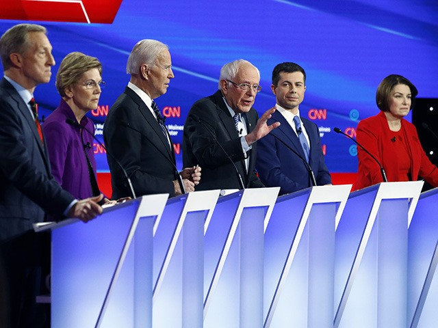 Democratic presidential candidate Sen. Bernie Sanders, I-Vt.,, center, speaks as fellow candidates businessman Tom Steyer, from left, Sen. Elizabeth Warren, D-Mass., former Vice President Joe Biden, former South Bend Mayor Pete Buttigieg and Sen. Amy Klobuchar, D-Minn. listen, Tuesday, Jan. 14, 2020, during a Democratic presidential primary debate hosted by …