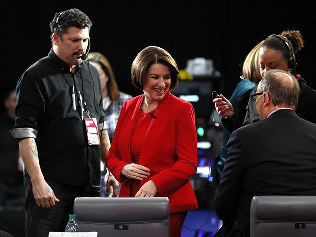 Democratic presidential candidate Sen. Amy Klobuchar, D-Minn., prepares to be interviewed in the spin room Tuesday, Jan. 14, 2020, after a Democratic presidential primary debate hosted by CNN and the Des Moines Register in Des Moines, Iowa. (AP Photo/Charlie Neibergall)