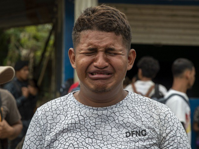 A teenage Honduran migrant traveling in a group of migrants cries as is he deported by Guatemalan police in Morales, Guatemala, Thursday, Jan. 16, 2020. Less-organized migrants, tighter immigration control by Guatemalan authorities and the presence of U.S. advisers have reduced the likelihood that the hundreds of migrants who departed …