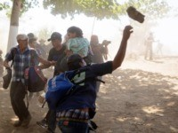 Photos Reveal Chaos as Rock-Throwing Caravan Migrants Push into Mexico