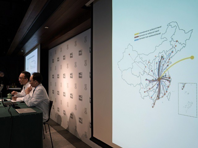 A screen shows a map of the Wuhan transportation in China as Professor Gabriel Leung, Founding Director of the WHO Collaborating Centre for Infectious Disease Epidemiology and Control, left, and Professor Joseph Wu, Division of Epidemiology and Biostatistics, School of Public Health, HKUMed, attend a news conference on the Wuhan …