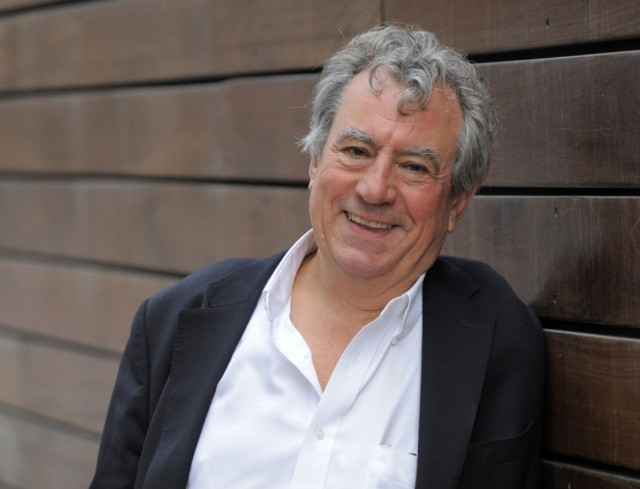 """Monty Python alumnus Terry Jones, featured in the 3-D animated film """"A Liar's Autobiography -- The Untrue Story of Monty Python's Graham Chapman,"""" poses for a portrait at the 2012 Toronto Film Festival, Friday, Sept. 7, 2012, in Toronto. (Photo by Chris Pizzello/Invision/AP)"""