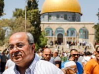 "Ahmed Tibi (R), Israeli-Arab politician and leader of the Arab Movement for Change party, poses for a picture with a man using his phone to take a ""selfie"", as he stands at the Aqsa mosque compound in the Old City of Jerusalem on August 16, 2019, with the Dome of …"