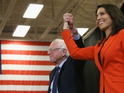 GETTYSBURG, PA - APRIL 22: Sen. Bernie Sanders (I-VT), is introduced to speak by Rep.Tulsi Gabbard, (D-HI),(R), during a campaign stop at the Bream Wright Hauser Athletic Complex at Gettysburg College, April 22, 2016 in Gettysburg, Pennsylvania. Pennsylvania will hold its 2016 primary election on Tuesday April 26th. (Photo by …