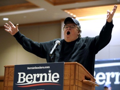 Filmmaker Michael Moore speaks in support of Democratic presidential candidate Sen. Bernie Sanders, I-Vt., Saturday, Jan. 25, 2020, on the campus of the University of Northern Iowa in Cedar Falls, Iowa. (AP Photo/Marcio Jose Sanchez)