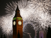 LONDON, ENGLAND - JANUARY 01: Fireworks light up the London skyline and Big Ben just after midnight on January 1, 2015 in London, England. For the first time thousands of people have bought tickets to stand on the banks of the River Thames near Parliament to celebrate the start of …