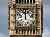 Technicians carry out cleaning and maintenance work on one of the faces of the Great Clock atop the landmark Elizabeth Tower that houses Big Ben, attached to the Houses of Parliament, in London, on August 19, 2014. A team of abseilers is busy this week cleaning up the clock faces …