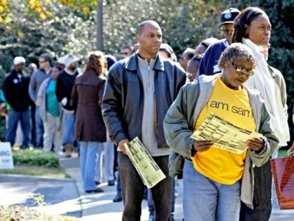 Voters stand in line at an early voting site in Charlotte, N.C., Thursday, Oct. 23, 2008. In three Southern states critical to deciding who will win the White House _ Georgia, Florida and North Carolina _ there are clear signs after several days of early voting that favor Democratic nominee …
