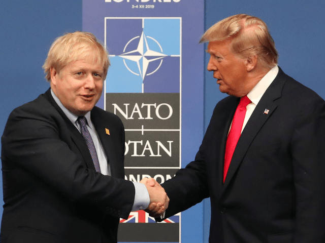 HERTFORD, ENGLAND - DECEMBER 04: British Prime Minister Boris Johnson shakes hands with US President Donald Trump onstage during the annual NATO heads of government summit on December 4, 2019 in Watford, England. France and the UK signed the Treaty of Dunkirk in 1947 in the aftermath of WW2 cementing …