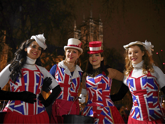 Brexit supporters dressed in Union flag-themed clothes, pose for a photograph as they wait for the festivities to begin in Parliament Square, the venue for the Leave Means Leave Brexit Celebration in central London on January 31, 2020, the day that the UK formally leaves the European Union. - Brexit …