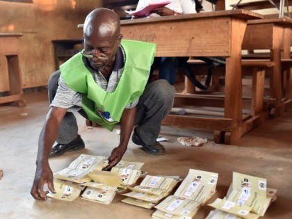 An election worker counts votes after polls closed following the second round presidential and legislatives elections in Bangui, on February 14, 2016. The Central African Republic held delayed presidential and parliamentary polls on February 14, with voters desperate to usher in peace after the country's worst sectarian violence since independence …