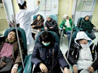 Chinese patients receive medical treatment at a hospital in Beijing, Thursday, Jan. 10, 2008. The rising cost of health care topped Chinese citizens' concerns in a government survey released Wednesday, a day after Beijing announced plans to reform the country's medical system. (AP Photo/Andy Wong)