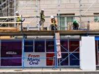 Construction workers put up support scaffolding on the side of a building in Washington, DC on October 8, 2019. - America's jobless rate tumbled in September to its lowest level in 50 years, helping assuage fears of an economic slowdown, according to government data released on October 4, 2019. (Photo …