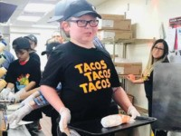 """David Turner, an eight-year-old, from Louisville, Kentucky, battling brain cancer landed an """"honorary job"""" as a Taco Bell employee for a day."""