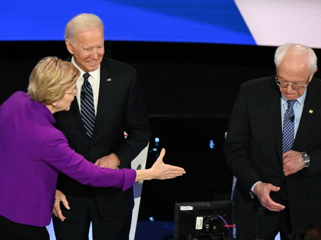 Democratic presidential hopefuls Massachusetts Senator Elizabeth Warren (L), Former Vice President Joe Biden (C) and Vermont Senator Bernie Sanders (R) arrive for the seventh Democratic primary debate of the 2020 presidential campaign season co-hosted by CNN and the Des Moines Register at the Drake University campus in Des Moines, Iowa …