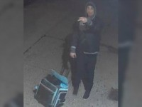 A man allegedly punched and beat a 63-year-old woman using her suitcase while on a New York City sidewalk shortly after the New Year's Eve ball drop, video footage shows.