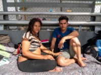 "Cuban migrants Dianys Dominguez Aguila, 21, and her boyfriend Andisley Gutierrez Fernandez, 28, have been waiting on the Paso Del Norte Bridge for days, seeking asylum on November 4, 2018 in El Paso, Texas. - Sending thousands of troops to the US-Mexico border to counter a migrant ""invasion,"" questioning the …"