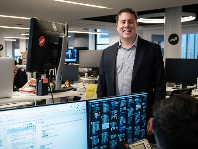 NEW YORK, NY - DECEMBER 11: BuzzFeed News Editor-in-Chief Ben Smith talks with colleagues in the newsroom at BuzzFeed headquarters, December 11, 2018 in New York City. BuzzFeed is an American internet media and news company that was founded in 2006. According to a recent report in The New York …