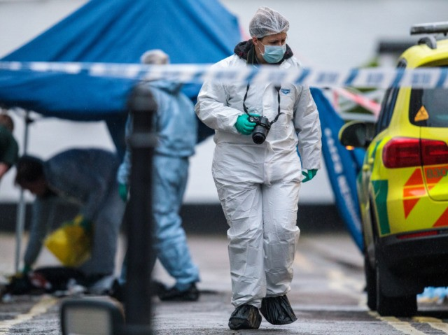 LONDON, ENGLAND - MARCH 07: Forensic officers on the scene following a stabbing in West Kensington on March 7, 2019 in London, England. A teenager has reportedly died from his injuries after being taken to hospital. (Photo by Jack Taylor/Getty Images)