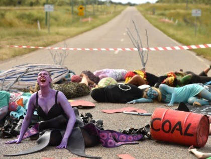 TOPSHOT - In this photo taken on May 1, 2019 shows environmental campaigners holding a protest against the development of the India-backed Adani coal mine at the entrance of Abbot Point port near the Queensland state town of Bowen, where the commodity will be shipped. - Tackling climate change has …