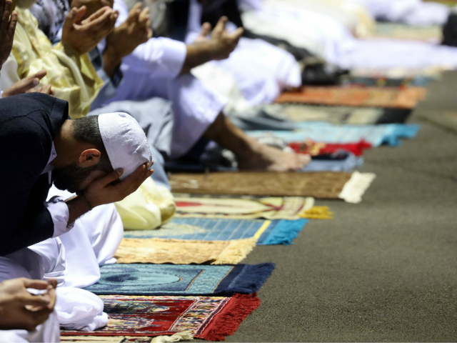 Muslim worshippers offer prayers during Eid al-Fitr at the Velodrome du Champ Fleuri stadium in Saint Denis de la Reunion, on the French Indian Ocean island of La Reunion on June 5, 2019. - Muslims worldwide celebrate Eid al-Fitr marking the end of the fasting month of Ramadan. (Photo by …