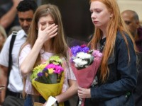 MANCHESTER, ENGLAND - MAY 22: A woman shows emotion during a two minute silence is observed in memory of the victims of the Manchester Bombing in Saint Anne's Square on May 22, 2019 in Manchester, England. The suicide bomb attack took place following a concert at Manchester Arena by US …