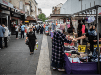 Customers shop at the Aubervilliers Market, north of Paris on July 18, 2019.