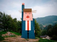 A wooden structure made to resemble US President Donald Trump is constructed in the village of Sela pri Kamniku, about 20 miles northeast of Ljubljana in Slovenia, the home country of Trump's wife on August 28, 2019. - The statute which is nearly 8 meters tall has been built on …
