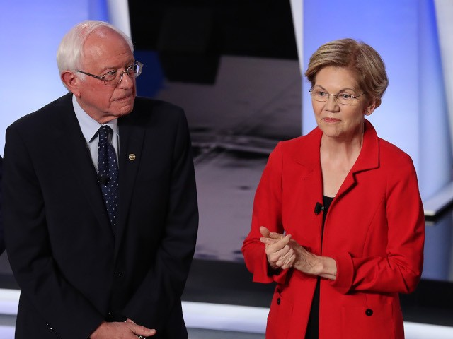 DETROIT, MICHIGAN - JULY 30: Democratic presidential candidates former Texas congressman Beto O'Rourke (L-R), Sen. Elizabeth Warren (D-MA), and Sen. Bernie Sanders (I-VT) take the stage at the Democratic Presidential Debate at the Fox Theatre July 30, 2019 in Detroit, Michigan. 20 Democratic presidential candidates were split into two groups …