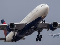 LONDON, ENGLAND - SEPTEMBER 09: A Delta Airlines and American Airlines flights comes in to land at Heathrow on September 9, 2019 in London, England. British Airways pilots have begun a 48 hour 'walkout', grounding most of its flights over a dispute about the pay structure of it's pilots. (Photo …