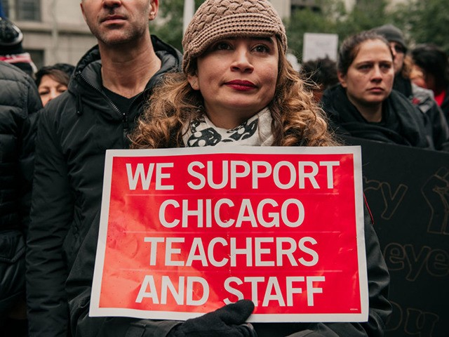 CHICAGO, IL - OCTOBER 23: Thousands of demonstrators took to the streets of Downtown Chicago, stopping traffic and circling City Hall in a show support for the ongoing teachers strike on October 23, 2019 in Chicago, Illinois. Union teachers and school staff members are demanding more funding from the city …