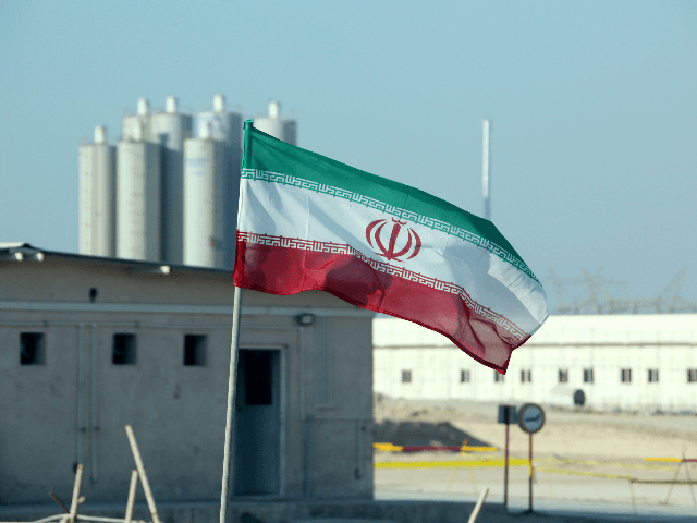 A picture taken on November 10, 2019, shows an Iranian flag in Iran's Bushehr nuclear power plant, during an official ceremony to kick-start works on a second reactor at the facility. - Bushehr is Iran's only nuclear power station and is currently running on imported fuel from Russia that is …