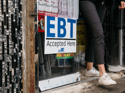 A sign alerting customers about SNAP food stamps benefits is displayed at a Brooklyn grocery store on December 5, 2019 in New York City. Earlier this week the Trump Administration announced stricter requirements for food stamps benefits that would cut support for nearly 700,000 poor Americans. (Photo by Scott Heins/Getty …