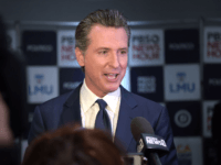 California Governor Gavin Newsom speaks to the press in the spin room after the sixth Democratic primary debate of the 2020 presidential campaign season co-hosted by PBS NewsHour & Politico at Loyola Marymount University in Los Angeles, California on December 19, 2019. (Photo by Agustin PAULLIER / AFP) (Photo by …